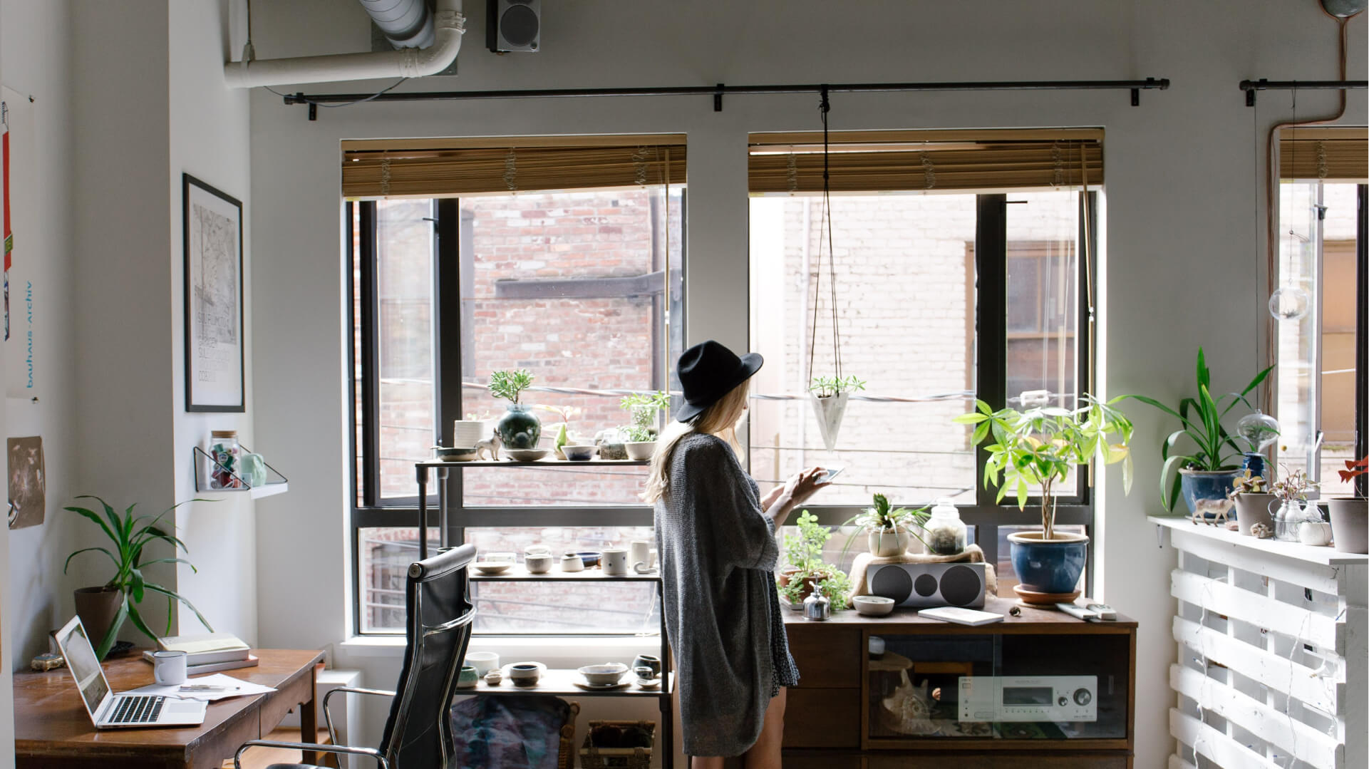 Woman in apartment with houseplants